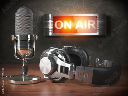 Vintage microphone  and headphones with signboard on air. Broadcasting radio station concept.