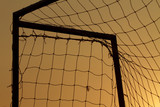 Closeup goal net with the sunset - 171949045