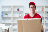 Post man delivering a parcel package