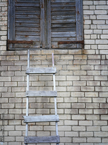 Foto op Plexiglas Baksteen muur Ladder And Brick Wall