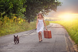 Young girl with suitcase and dog - 171959648