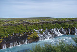A wide and huge Waterfall that ends up in a beautiful blue river