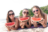 Female friends eating watermelon - 171986401