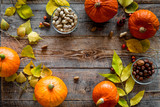 Pumpkin harvest. Pumpkins near nuts and autumn leaves on wooden background top view copyspace - 171988879