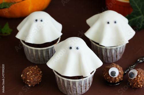 A cake for halloween in the form of a ghost. Poster