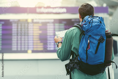 Adult traveler is checking his flight details