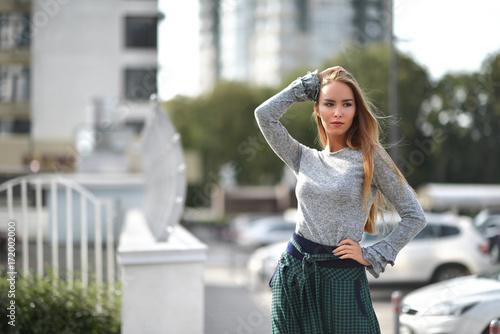 Sticker Pretty woman on a street in autumn fashion cloth windy hair