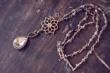 Beautiful romantic necklace on the wooden table