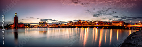 Plexiglas Stockholm Stockholm sunset skyline with City Hall as seen from Riddarholmen. Panoramic montage from 13 images