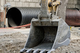 Large excavator bucket, trumpet in the background. Replacement of pipes - 172010495