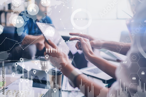 Concept of digital diagram,graph interfaces,virtual screen,connections icon on blurred background.Business meeting process.Woman pointing to touch tablet display.Horizontal.Cropped.