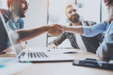 Business partnership handshake concept.Photo two coworkers handshaking process.Successful deal after great meeting.Horizontal, blurred background.