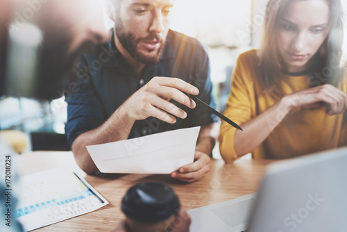 Teamwork concept.Business team sitting at meeting room and making conversations.Horizontal.Blurred background.