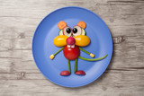 Funny vegetable mouse made on plate and wooden background