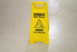 Slippery when wet warning sign in doors on the floor - 172042884