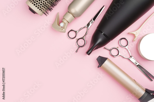 Fototapeta Professional hairdressing tools on pink background with copy space