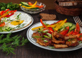Fried meat with vegetables and eggs - 172051280