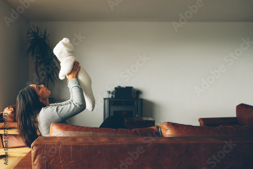 Woman playing with her baby boy at home