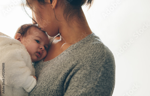 Newborn baby boy in his mother's arms