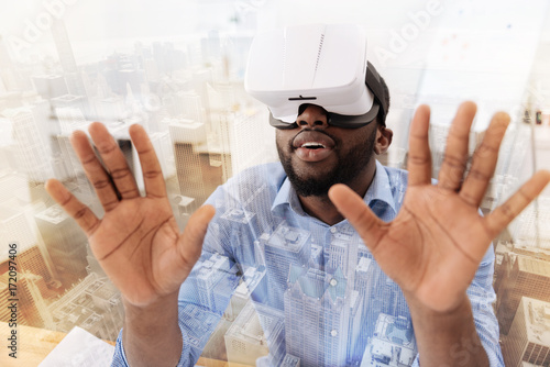 Relaxed man using virtual mask