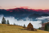 Foggy dawn in the autumn in the mountains. - 172102647