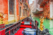 Views of the most beautiful channels of Venice, front of the boat the gondola, floating along the canal.Italy.