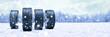 Leinwandbild Motiv Winterreifen im Schnee im Winter als Panorama