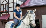 Horse rider woman near stable horsewoman before training - 172119675