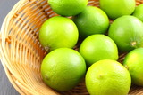 fresh lime fruits in a basket - 172120481