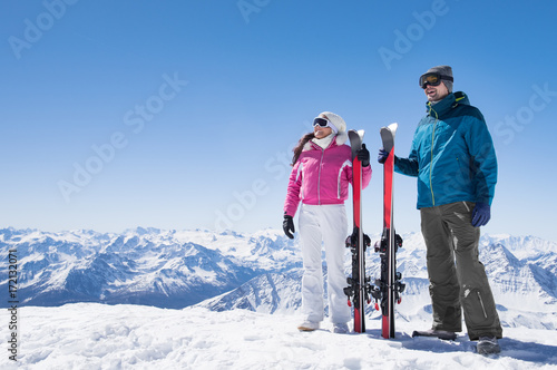 Couple holding ski