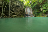 Breathtaking green waterfall at deep forest, Erawan waterfall located Kanchanaburi Province, Thailand