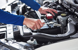 Hands of car mechanic with wrench in garage - 172158435