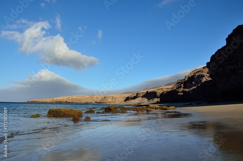 Deurstickers Canarische Eilanden Beautiful beach with intense blue sky, Las coloradas, Fuerteventura island