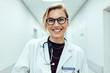 Female doctor standing in hospital corridor