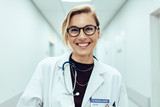Female doctor standing in hospital corridor - 172186647