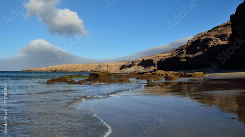 Fotobehang Canarische Eilanden Stunning sandy beach and rocks, Las coloradas, coast of Fuerteventura, Canary islands