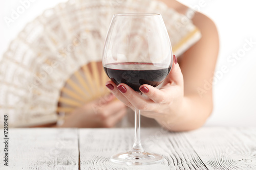 Woman in lingery drink red wine, alcohol for relax