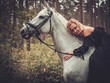 Romantic middle-aged woman with her horse