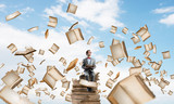 Young businessman or student studying the science and books fly around - 172190486