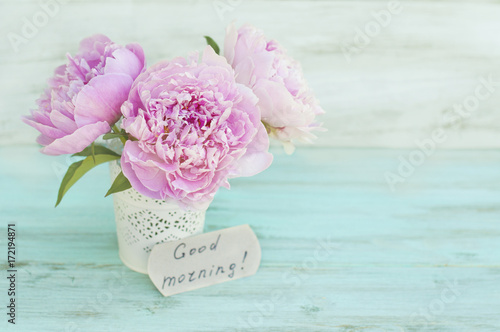 Greeting card, peonies and the inscription