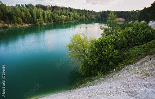 Fotobehang Zomer Lake with blue water. Beautiful scenery of Belarus. Cretaceous quarries near Grodno