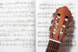 closeup of acoustic guitar on music notes - 172209074