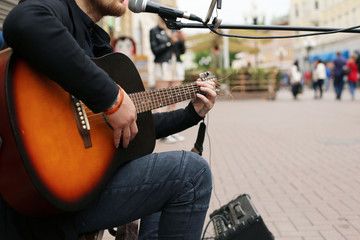 A street musician playing the guitar.