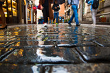 People walking on wet paving stones in rainy day in old town of Prague - 172214097