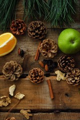 Christmas wood background with fruits and spices