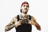 tattooed rap singer posing in studio on a white background - 172239407