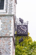 Saint Jean Baptiste area with closeup of clock time at Claire Martin library on sidewalk in Quebec City, Canada