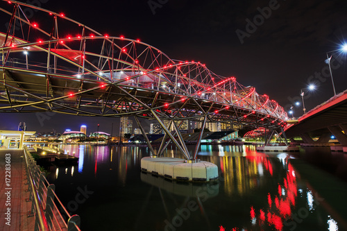 The Helix Bridge in Singapore city at night Poster