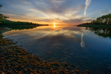 Reflections over Aspy Bay at sunrise © JONATHAN