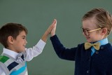 Kids as business executive giving high five to each other - 172304068